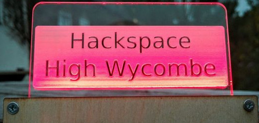 Illuminated laser engraved sign with Hackspace High Wycombe writton on it